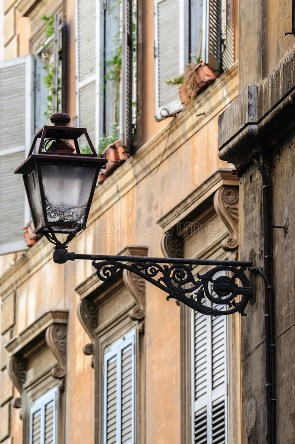Old streets of Rome, Italy. Lantern on wall, old streets of Rome, Italy royalty free stock photo