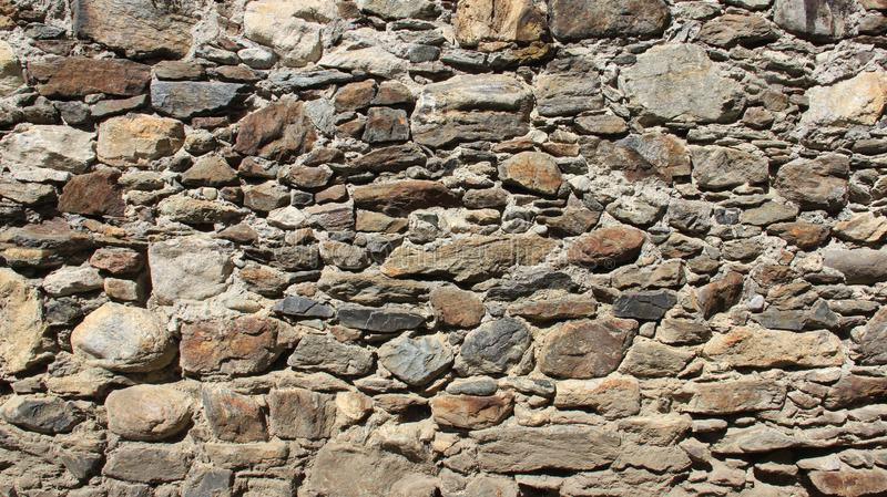 Old stron Stone Walls Of Historic Old Town. Strong walls. sunlight and old stone walling in old town. Tirano Italy stock photo