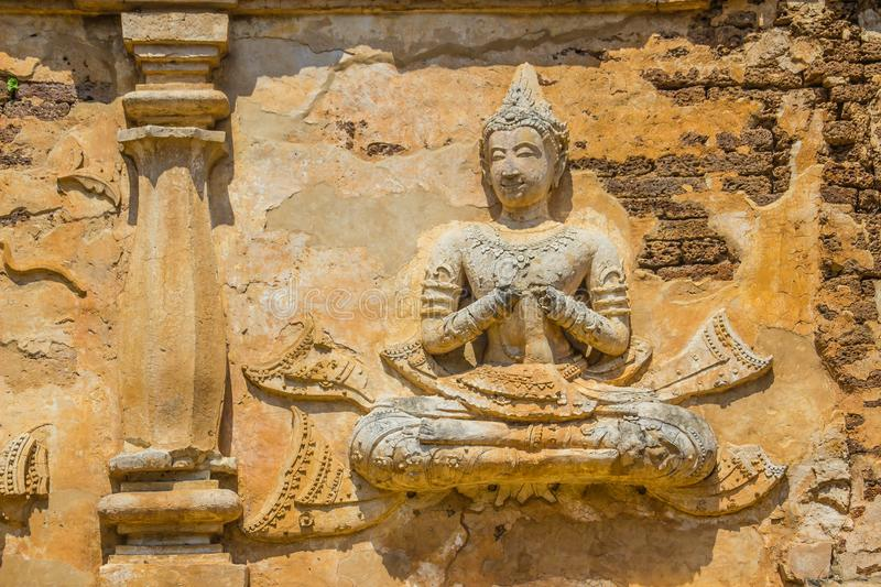 Old stucco Buddha and angel figures on the outside of the Maha Chedi of Wat Chet Yot (Wat Jed Yod) or Wat Photharam Maha Vihara, t. He public Buddhist temple royalty free stock images
