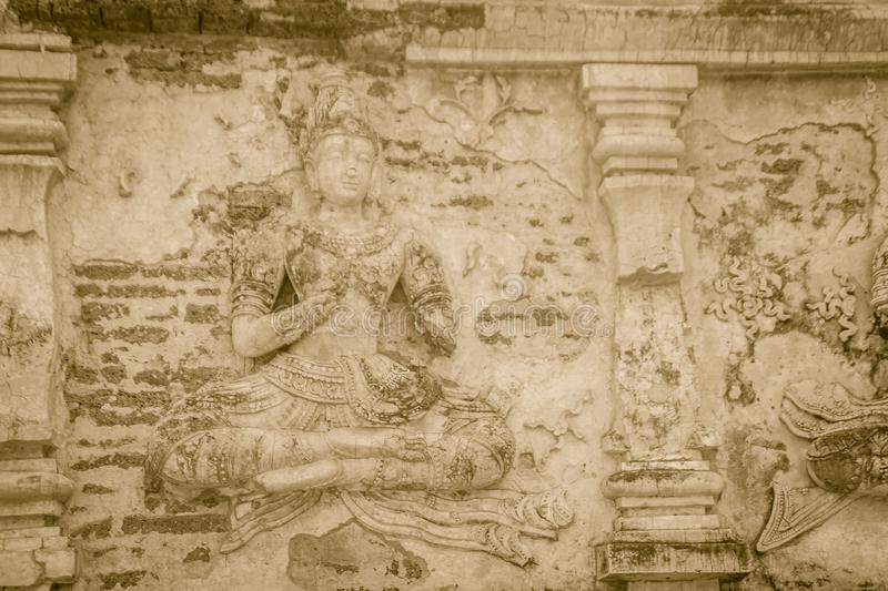 Old stucco Buddha and angel figures on the outside of the Maha Chedi of Wat Chet Yot (Wat Jed Yod) or Wat Photharam Maha Vihara, t royalty free stock photos