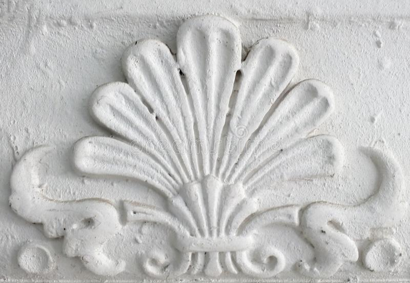 Old stucco molding. Vintage decorative element on white wall texture stock photo