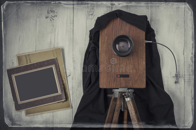 Old studio camera and old photos. The old studio camera and two old photos.The stylized photo royalty free stock photos
