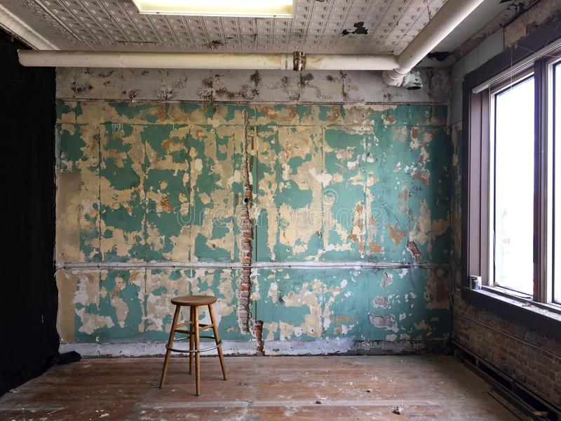Old studio walls with stool 01 royalty free stock photos