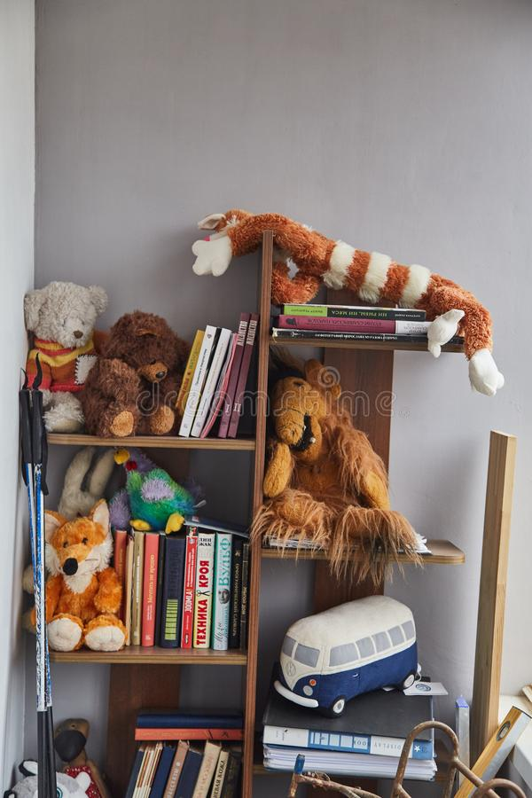 Old stuffed toys on the shelves royalty free stock photo