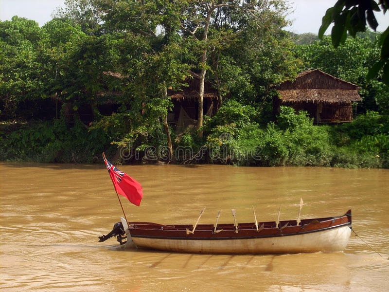 Old Style Boat With Flag At Muddy River Stock Images