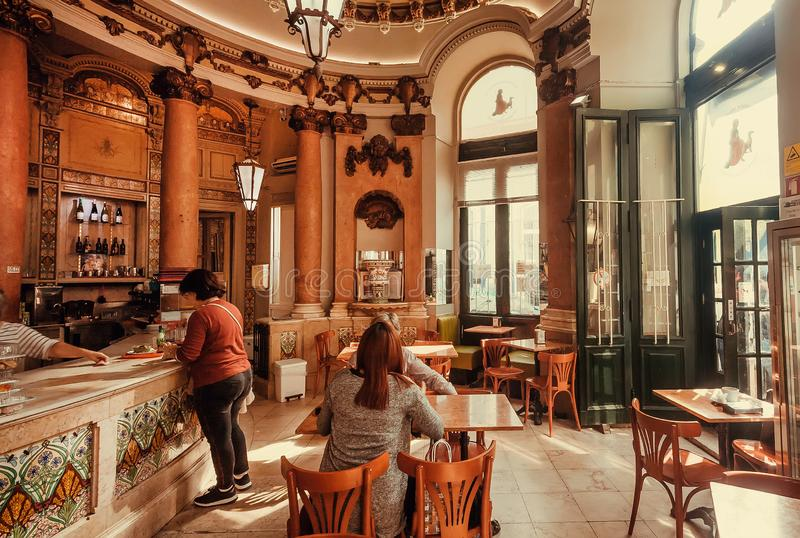 Old style cafe and some women meeting for coffee in vintage luxury interior. LISBON, PORTUGAL: Old style cafe and some women meeting for coffee in vintage luxury royalty free stock photo