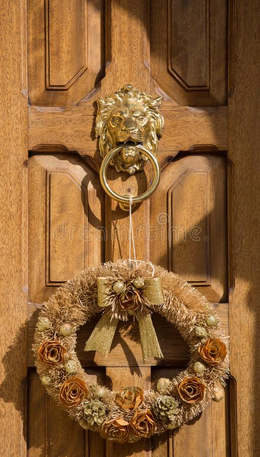 An old style decorative bronze door handle on a wooden door, the distinctive feature and symbol of Malta in Mdina. An old style decorative bronze door handle on royalty free stock images