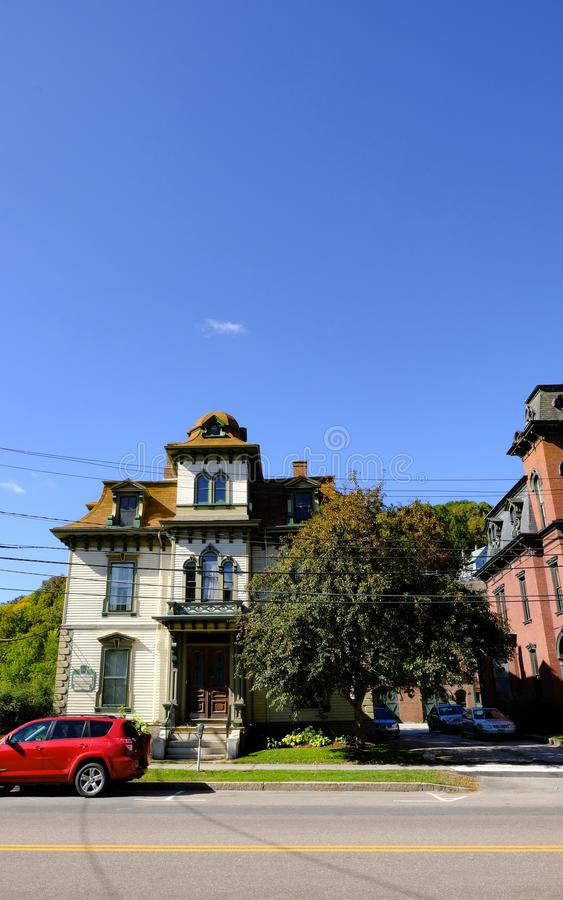 Old-style US multi-storey home seen in a American suburb. stock photography