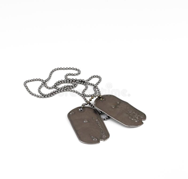 Old style dog tags on white royalty free stock photo