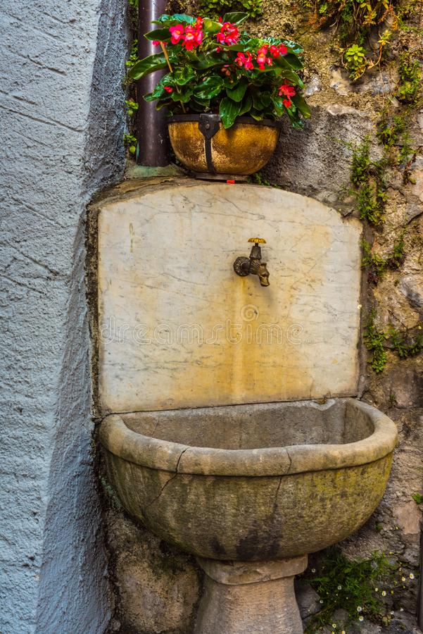 Old style drinking fountain at the Italy stock photo
