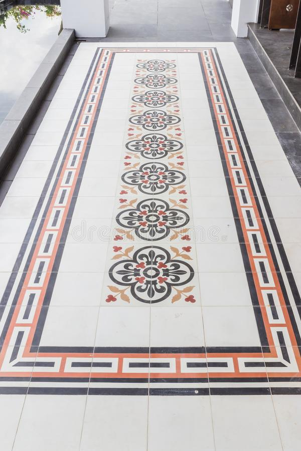 Old style floor tiles of Sino-Portuguese style building stock photography