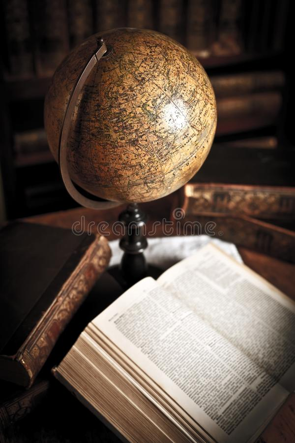 Old style globe. Vintage globe on the table among books