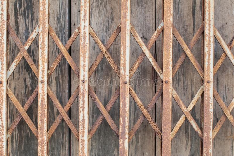Old style grunge metal door. rustic expanded metal shutter door close. Expanded metal sliding gate. Old style grunge metal door. rustic expanded metal shutter stock photography