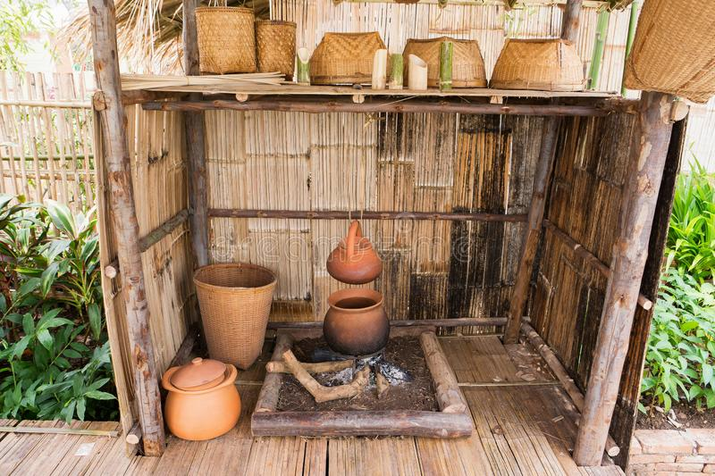 Old style of hill tribe fireplace kitchen with kitchenware royalty free stock photography