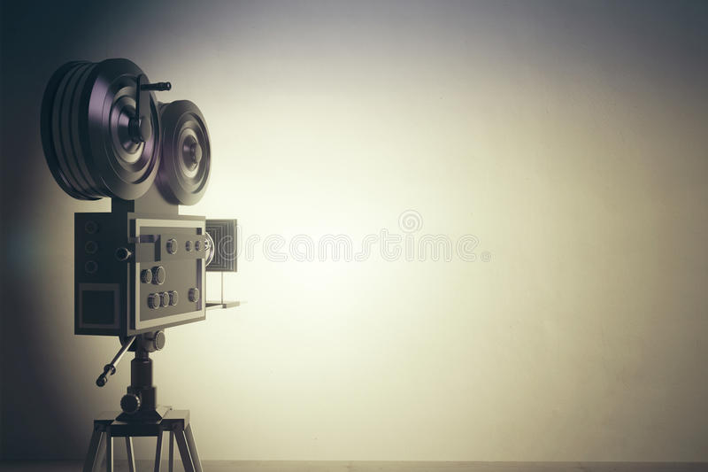 Old style movie camera with white wall, vintage photo effect stock photo
