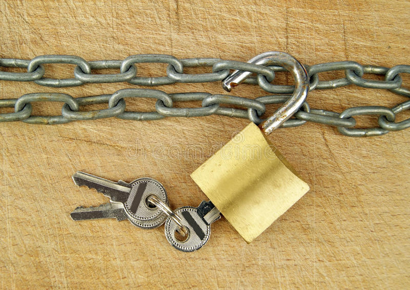 Old Style Padlock and Chain. On wood royalty free stock images