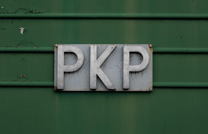 Old style PKP sign on the old car. Old style PKP sign on the old green car. Polskie Koleje Państwowe royalty free stock image