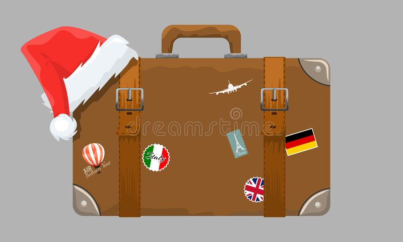 Old style vintage brown voyage suitcase with travel stickers and christmas or santa claus hat or cap. Vector vector illustration