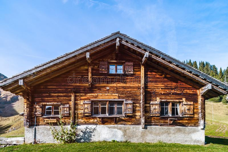Old -styled wooden hut in the mountains, ski resort at autumn royalty free stock image