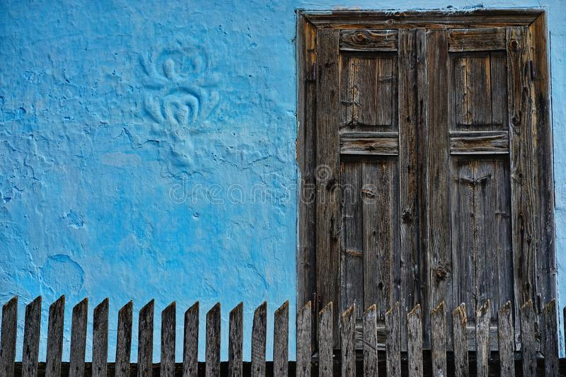 Closed windows on the blue house. Old stylish closed windows on the blue house royalty free stock photography