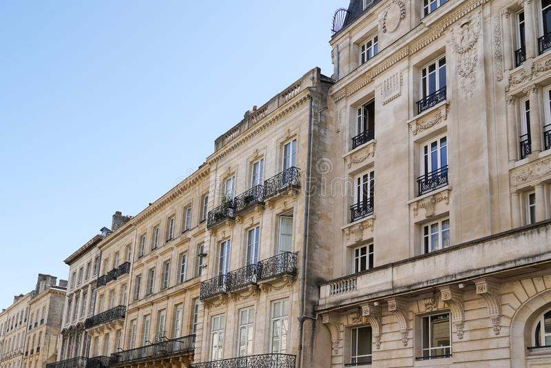 Old and stylish hausmann building facades in Bordeaux. An Old and stylish hausmann building facades in Bordeaux stock photo
