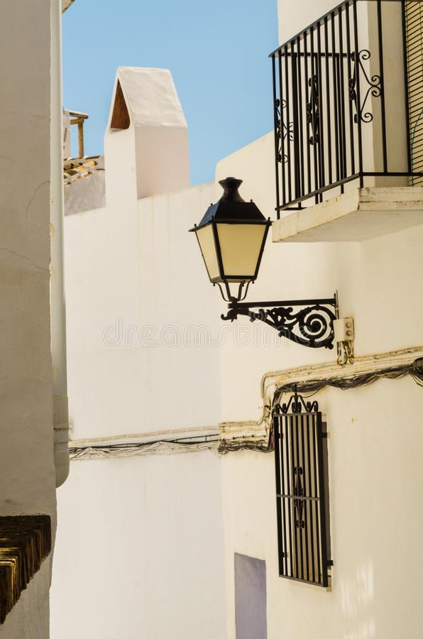 old stylish street lamp illuminating the Spanish street, a characteristic element of traditional street architecture royalty free stock photos