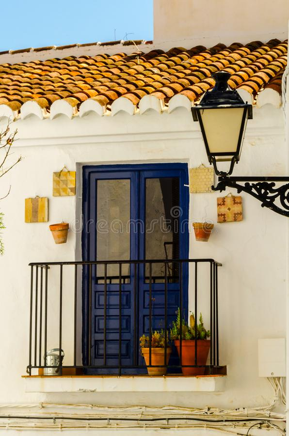 Old stylish street lamp illuminating the Spanish street, a characteristic element of traditional street architecture. Decor royalty free stock photo