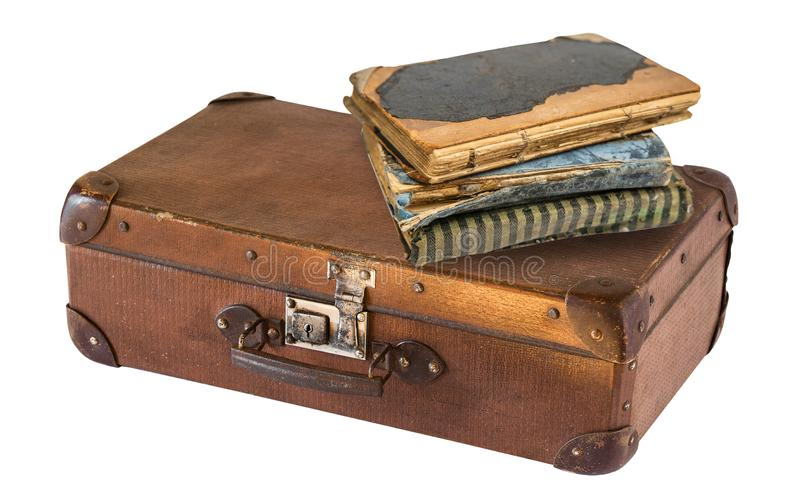 Old suitcase and books isolated on white background. Retro style stock photography