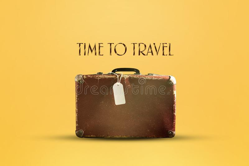 Old suitcase on a brown background. The inscription Time to travel. Concept vacation royalty free stock photography