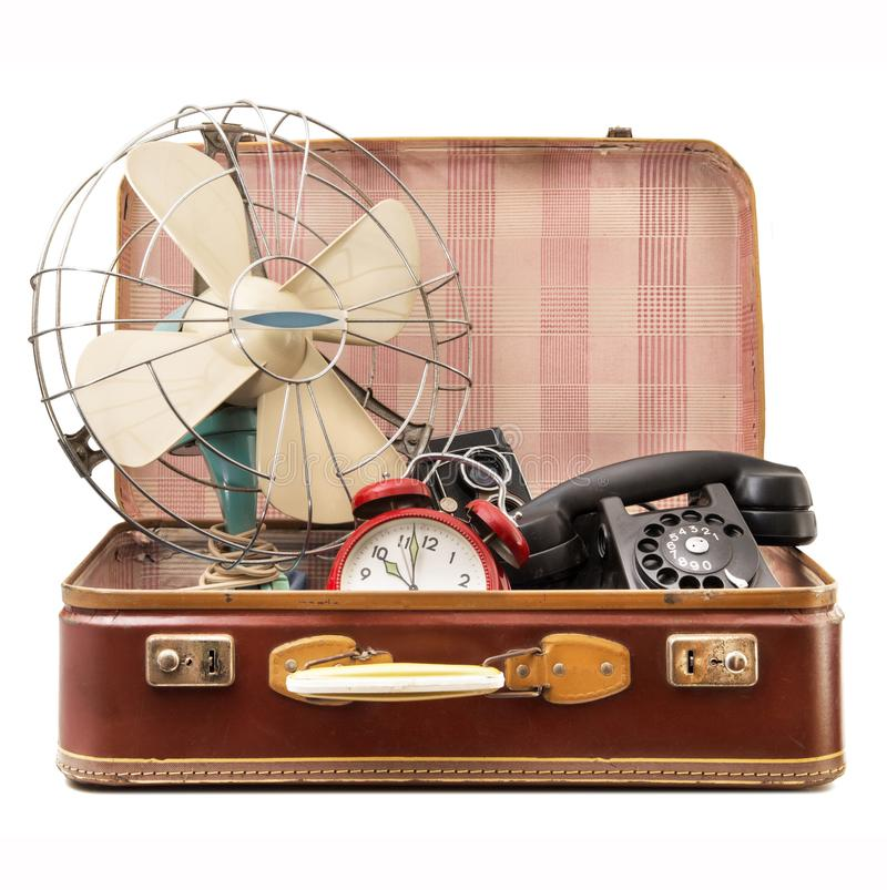 Vintage suitcase full of vintage objects royalty free stock image