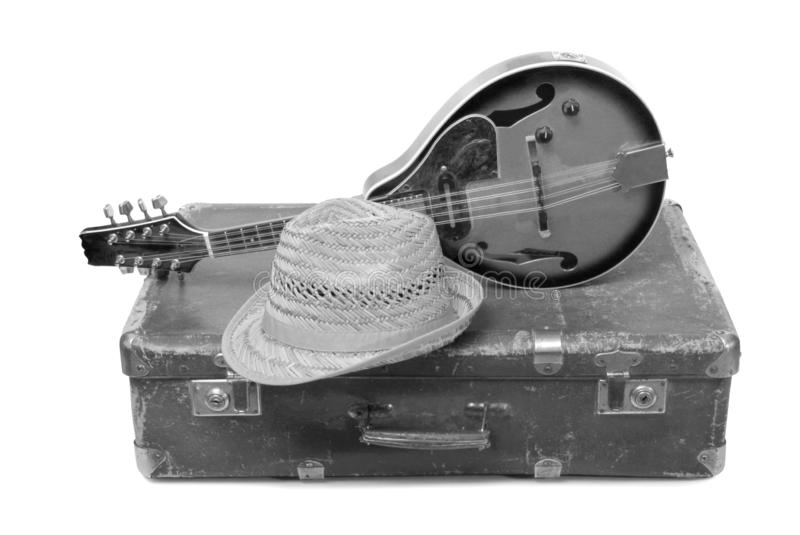Hat and mandolin one. Old suitcase and mandolin in country style on a white background stock photo