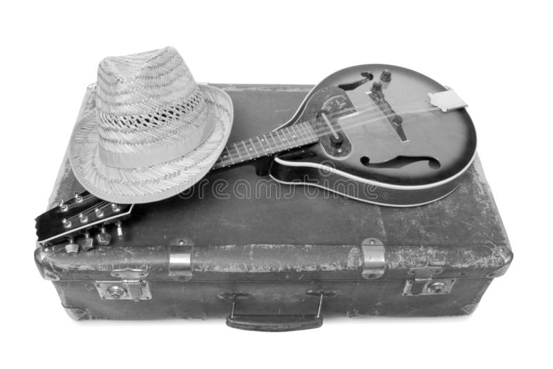 Hat and mandolin two. Old suitcase and mandolin in country style on a white background stock image