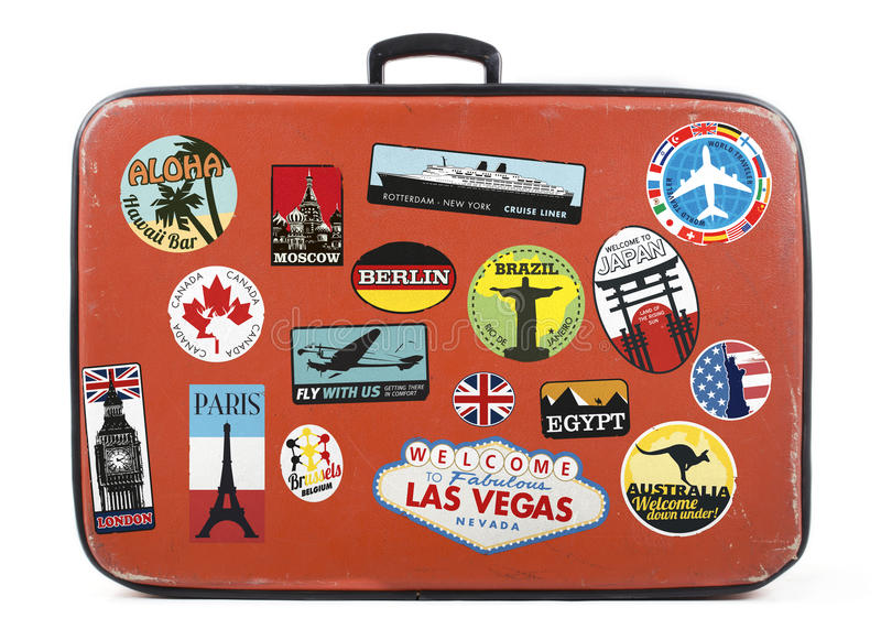 Old suitcase with stickers stock photo
