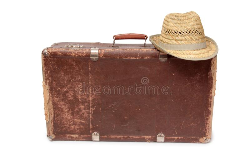 Suitcase and a straw hat two stock photo