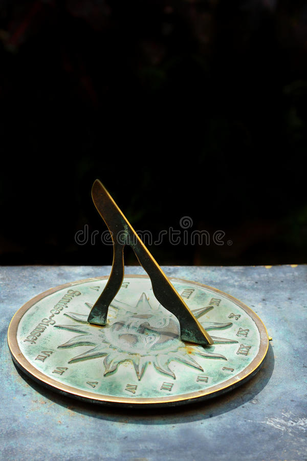 Old sun clock dial stock photo