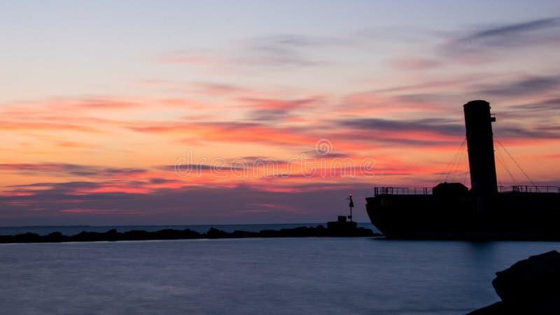 Old Sunken Freighter At Sunrise stock image