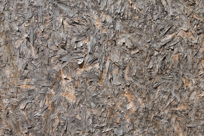 Old surface of the wood particle board. The old brown surface of the wood particle board stock photography