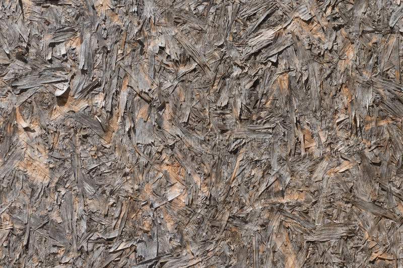 Old surface of the wood particle board. The old brown surface of the wood particle board royalty free stock images