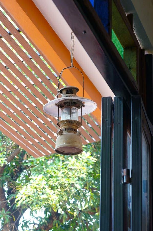 An hanging lamp. An old suspended metallic lantern stock image