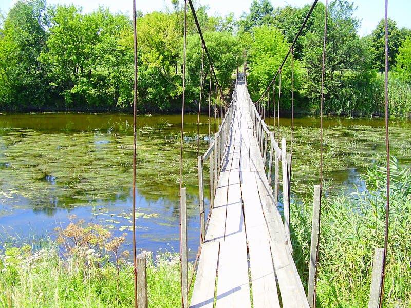 Ukraine, 2010, Shevchenko Korsun, river Ros. Old suspension bridge, freshmen, village, Karashina royalty free stock photos