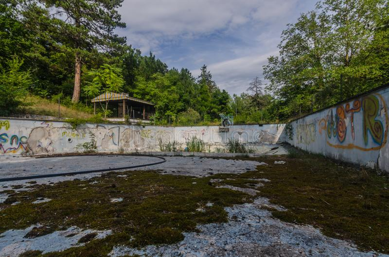 old swimming pool in the forest stock photos