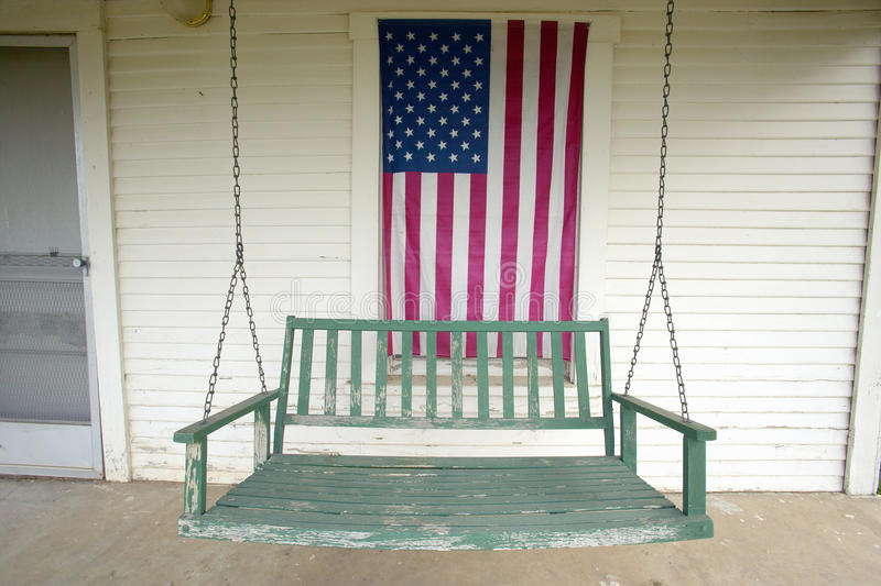 Old swing on porch royalty free stock photos