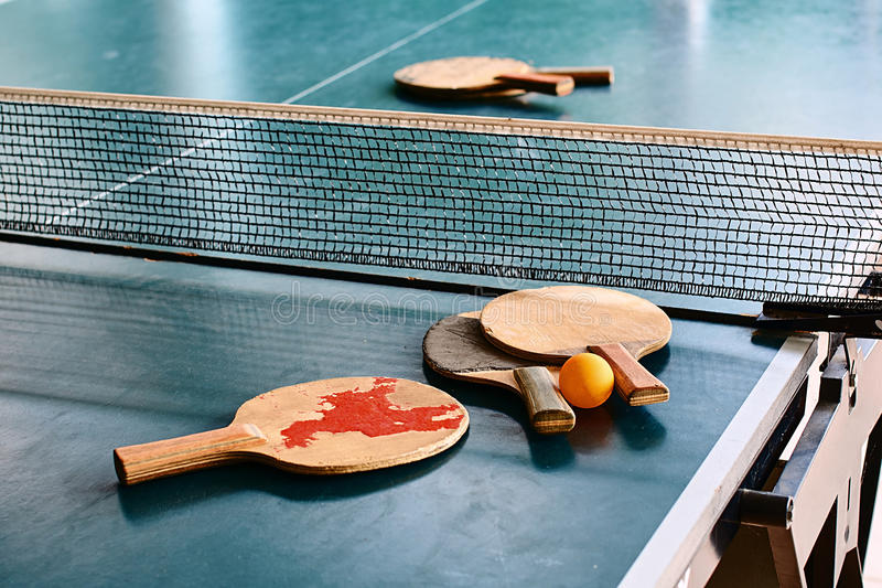 Old table tennis rackets on the game table stock photography