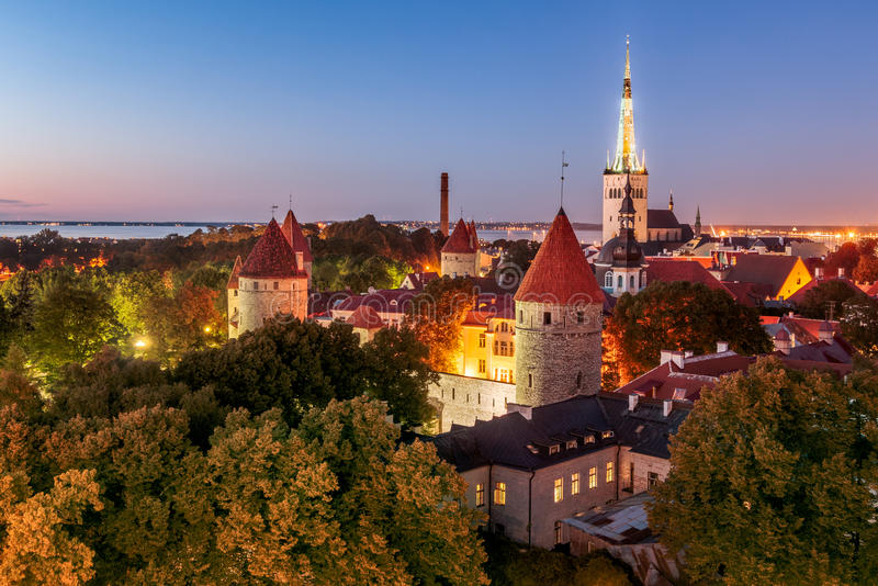 Old Tallinn, city walls, towers, churches and Bay of Tallinn by. A panorama over Old Town of Tallinn city walls parks and towers. Main churches prominent in the stock photos
