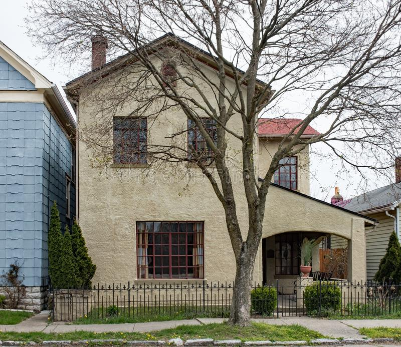 Well-liked Old Tan Stucco House With Bare Spring Tree Stock Image - Image of  MC52