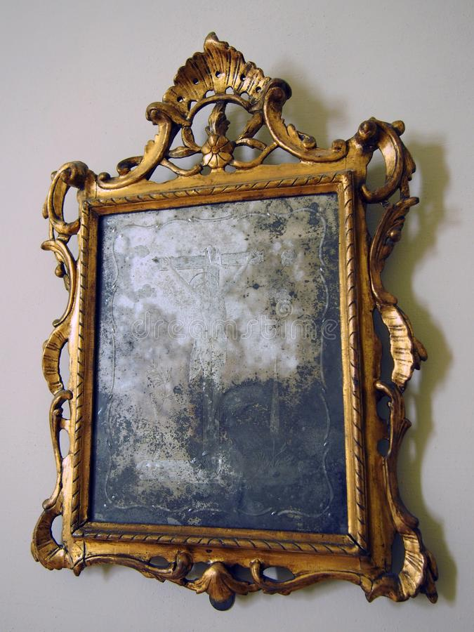old tarnished gold framed mirror with ornate baroque details royalty free stock photos