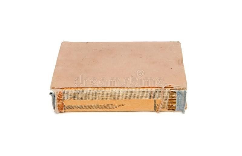 Old tatty book with torn out cover back isolated. On white royalty free stock image