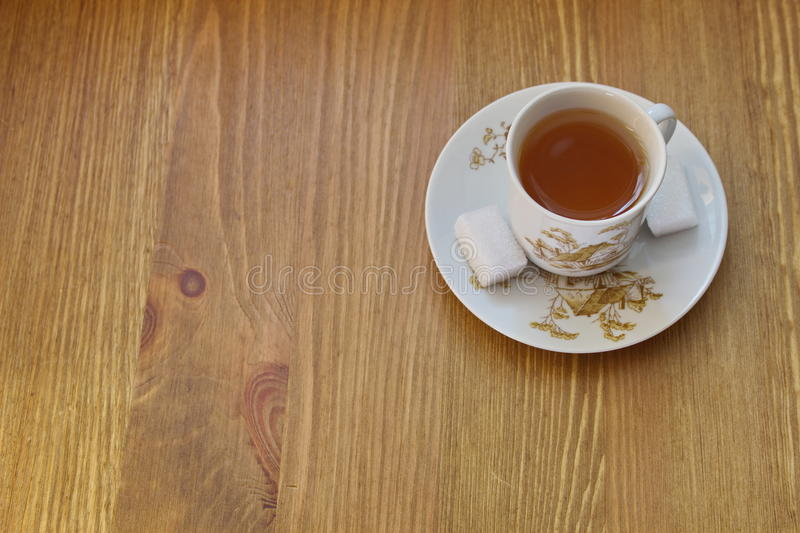 Old tea cup with pattern of countryside house stock images