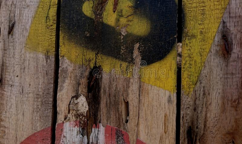 Old teak wood texture with damaged paint royalty free stock photo