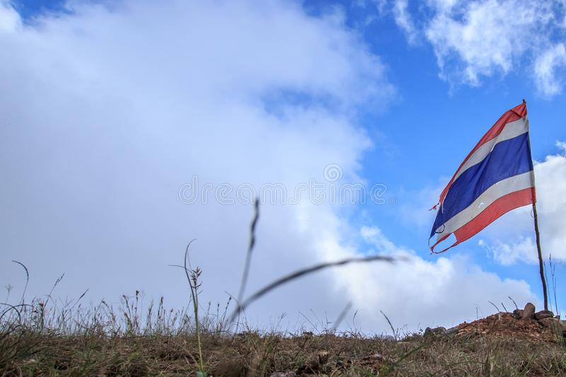 Old or tear of Thailand flag on the hill or mountain. Flag nation background stock photography